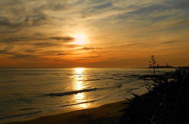 things to do in Andalucia - sunset in El Palmar. Fotografía de lasdostorres.com